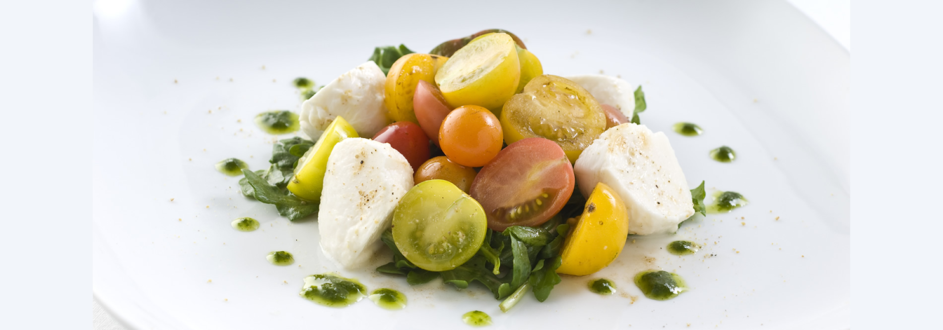 Arugula with mozzarella, heirloom cherry tomatoes and basil vinaigrette
