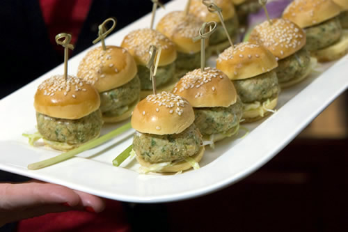 Close-up of tuna sliders with cabbage slaw and lemon aioli on sesame seed brioche buns